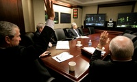 President George W. Bush and Vice President Dick Cheney wave from the Situation Room of the White House, March 19, 2007, as they're joined in a video teleconference by Prime Minister Nouri al-Maliki of Iraq.
