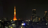 Tokyo Tower is lit orange in the Tokyo skyline before turning off its lights, Mar. 27, 2010. Tokyo Tower turned off the lights later for 1 hour during the annual Earth Hour, calling for a binding pact to cut greenhouse-gas emissions.