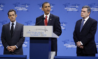 President Barack Obama, accompanied by French President Nicolas Sarkozy, left, and British Prime Minister Gordon Brown, makes a statement on Iran's nuclear facility, Sep. 25, 2009, during the G-20 summit in Pittsburgh.