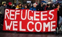 "People holding ""Refugees Welcome"" sign in Germany"