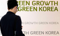 Sep. 18, 2009: a visitor tours the Experience Green Growth Center in downtown Seoul, ROK. ROK President Lee Myung-bak sees a crisis coming for Asia's 4th-largest economy, one of the world's biggest GHG polluters, amid calls to curb climate change.