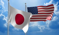Japanese and U.S. flags flying together for diplomatic talks