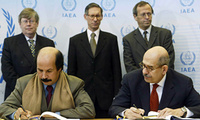 Libya's Science and Research Minister Matouq Mohamed Matouq and IAEA's Director General Mohamed ElBaradei, from left, sign an agreement opening up Libya's nuclear activities to IAEA inspections on Mar. 10, 2004, in Vienna.