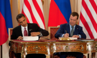 President Barack Obama and President Dmitry Medvedev of Russia sign the New START Treaty during a ceremony at Prague Castle in Prague, Czech Republic, April 8, 2010.