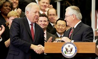 Secretary of State Rex Tillerson shakes hands with then-Acting Secretary of State Tom Shannon
