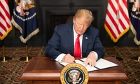 President Donald J. Trump signs an EO on Iran Sanctions in the Green Room at Trump National Golf Club, August 5, 2018, in Bedminster Township, New Jersey.