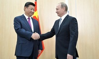 Russian President Vladimir Putin shakes hands with Chinese President Xi Jinping at the BRICS summit, July 8, 2015