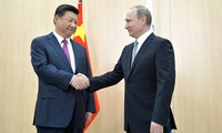 Xi Jinping and Vladimir Putin shaking hands at the BRICS Summit, July 8, 2018