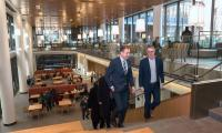 Icelandic President Guðni Th. Jóhannesson walks through Harvard Kennedy School with Belfer Center Co-Director Eric Rosenbach.