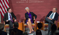 Left-to-right: Nicholas Burns, Christine Lagarde, and Lawrence Summers laugh.