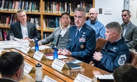 Gen. John Hyten (right), Commander of the United States Strategic Command, speaks with the National Security Fellows.