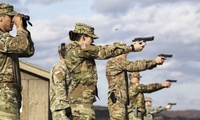 KFOR Multinational Battle Group-East Soldiers fire the M9 pistol from the firing line during the weapons qualification event for the German Armed Forces Proficiency Badge at Camp Bondsteel, Kosovo, Dec. 12, 2017. (U.S. Army Photo / Staff Sgt. Nicholas Farina)