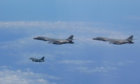 Two U.S. Air Force B-1B Lancers assigned to the 9th Expeditionary Bomb Squadron, deployed from Dyess Air Force Base, Texas, fly with a Koku Jieitai (Japan Air Self-Defense Force) F-2 fighter jet over the East China Sea, July 7.