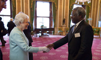 Calestous Juma meets with Queen Elizabeth II at Buckingham Palace to celebrate the first Queen Elizabeth Prize for Engineering on June 25, 2013.