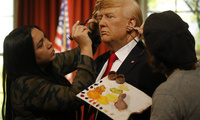 Madame Tussauds' designers apply the final touches to the wax figure of US President-elect Donald Trump, as they unveil the figure just days ahead of the American's Presidential Inauguration in Washington in London, Wednesday, Jan. 18, 2017. The figure will now reside in Madame Tussauds' London Oval Office alongside fellow famous politicians and global icons also immortalised in wax.