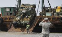 South Korean army's K-55 self-propelled artillery vehicle is unloaded from a barge during a Combined Joint Logistics Over-the-Shore exercise of U.S. and South Korea Combined Forces Command at the Anmyeon beach in Taean, South Korea, Monday, July 6, 2015. The U.S. and South Korean military joint exercise are held from June 29to July 9.