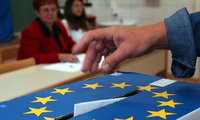 A Slovenian casts his ballot in a box bearing a European Union crest at a polling station in Grosuplje near Ljubljana, Sunday, Oct. 3, 2004. Nationwide general elections are taking place in Slovenia on Sunday. Slovenia joined the EU and NATO earlier this year.