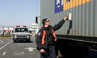 A U.S. Customs and Border Protection officer uses a handheld GR135- Radiation Isttope Identifier to check a container that was stopped after passing through a radiation detection device at the port of Newark in February 2006 (AP Photo/Mel Evans).
