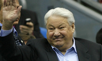 Former Russian President Boris Yeltsin waves during a Davis Cup Final tennis match in Moscow. Yeltsin engineered the final collapse of the Soviet Union and pushed Russia to embrace democracy and a market economy as the country's first post-Communist president