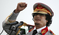 In this June 12, 2010 file photo, Libyan leader Moammar Gadhafi talks during a ceremony to mark the 40th anniversary of the evacuation of the American military bases in the country, in Tripoli, Libya (AP Photo/ Abdel Magid Al Fergany, File).
