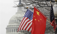 The American and Chinese flags fly side-by-side in anticipation of the Chinese President's visit, January 18, 2012.
