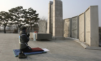 A South Korean Buddhist prays for peace on the Korean Peninsula near the border village of Panmunjom at the demilitarized zone on Friday, December 30, 2011. (AP Photo/Ahn Young-joon)