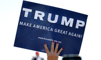 A supporter holds a sign as Republican presidential candidate Donald Trump speaks during a campaign rally, Saturday, March 19, 2016, in Fountain Hills, Ariz. (AP Photo/Matt York)