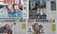 In this image made on Friday, April 27, 2012, pages of rival Taiwan newspapers Apple Daily, top half, and The China Times, bottom, are seen depicting each other's owners in a fight for ownership of a major chunk of Taiwan's media outlets. (AP)