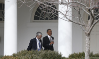 President Barack Obama walks with John P. Holdren, Assistant to the President for Science and Technology and Director of the White House Office of Science and Technology Policy, at the White House in Washington, Friday, March 7, 2014.