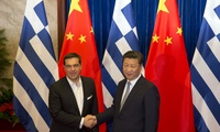 Greek Prime Minister Alexis Tsipras, left shakes hands with Chinese President Xi Jinping during a meeting at the Great Hall of the People in Beijing, China on July 5, 2016 (AP Photo/Ng Han Guan, Pool).