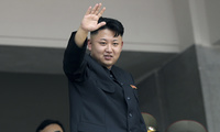 Photo of Kim Jong Un waving in 2013.