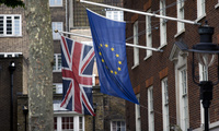 A European, right, and Union flags are displayed outside Europe House, the European Parliament's British offices, in London, Wednesday, June 22, 2016. (AP Photo/Matt Dunham)