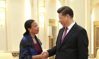 U.S.-China Engagement: U.S. National Security Advisor Susan Rice (left) and Chinese President Xi Jinping shake hands during their meeting at the Great Hall of the People in Beijing, China on July 25, 2107