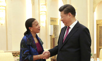 U.S. National Security Advisor Susan Rice (left) and Chinese President Xi Jinping shake hands during their meeting at the Great Hall of the People in Beijing, China on July 25, 2016.
