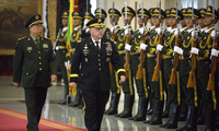 China's People's Liberation Army (PLA) Gen. Li Zuocheng, left, and U.S. Army Chief of Staff Gen. Mark Milley, center, review an honor guard during a welcome ceremony at the Bayi Building in Beijing. (AP Photo/Mark Schiefelbein, Pool)