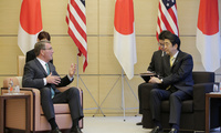 U.S. Defense Secretary Ash Carter, left, and Japan's Prime Minister Shinzo Abe talk together at the start of their talks at Abe's official residence in Tokyo, Japan, Tuesday, December 6, 2016.
