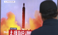 In this Oct. 16, 2016, file photo, a man in Seoul, South Korea watches a TV news program showing an image of a missile launch conducted by North Korea. (AP Photo/Ahn Young-joon, File)