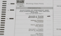 In this Dec. 5, 2016, file photo, a ballot with a vote for Donald J. Trump is shown during a statewide presidential election recount in Waterford Township, Mich. Recounts of the presidential vote in three states highlight major vulnerabilities in the U.S. election system. (AP Photo/Paul Sancya, File)