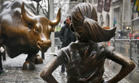 "The ""Fearless Girl"" statue stands across from the ""Charging Bull"" statue in New York on Monday, March 27, 2017. (AP Photo/Bebeto Matthews)"