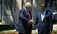 Presidents Trump and Xi shake hands.