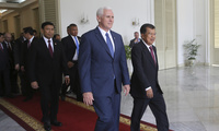 U.S. Vice President Mike Pence, center, walks with his Indonesian counterpart Jusuf Kalla, right, and top security minister Wiranto, left, after their meeting in Jakarta, Indonesia, Thursday, April 20, 2017. Indonesia is the latest stop on an Asian tour by Pence that is reinforcing traditional U.S. alliances at a time when Donald Trump's presidency has raised questions about the strength of the U.S. commitment to the region.