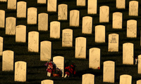Headstones glow in the late day sun ahead of Memorial Day at Leavenworth National Cemetery, Sunday, May 28, 2017, in Leavenworth, Kan. (AP Photo/Charlie Riedel)