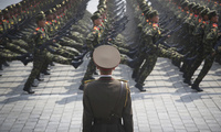soldiers goose-step across Kim Il Sung Square in Pyongyang, North Korea