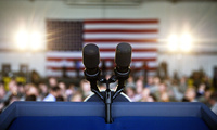 Microphones sit on a podium following Vice President Mike Pence's speech at an event at Dobbins Air Reserve Base in Marietta, Ga., Friday, June 9, 2017.