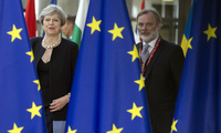 British Prime Minister Theresa May, left, and UK representative to the EU Tim Barrow arrive for an EU summit at the Europa building in Brussels on June 22, 2017 (AP Photo/Virginia Mayo).