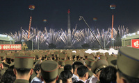 "Soldiers and residents watch fireworks in Kim Il Sung Square in Pyongyang, North Korea, Thursday, July 6, 2017, as they celebrate the test launch of North Korea's first intercontinental ballistic missile two days earlier. The North's ICBM launch, its most successful missile test to date, has stoked security worries in Washington, Seoul and Tokyo as it showed the country could eventually perfect a reliable nuclear missile capable of reaching anywhere in the United States. Analysts say the ""Hwasong 14"" missil"