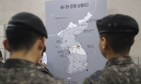"South Korean soldiers look at a map illustrating about the Korean War at the Korea War Memorial Museum in Seoul, South Korea, Friday, July 7, 2017. South Korea's new liberal President Moon Jae-in reiterated he's willing to meet North Korean leader Kim Jong Un even as he condemned the North's first intercontinental ballistic missile test-launch this week as a ""reckless"" move that incurred punishment by the international community. (AP Photo/Lee Jin-man)"
