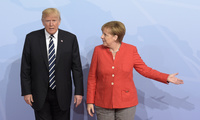 U.S. President Donald Trump, left, is welcomed by German Chancellor Angela Merkel on the first day of the G-20 summit in Hamburg, northern Germany, Friday, July 7, 2017. The leaders of the group of 20 meet July 7 and 8. (AP Photo/Jens Meyer)