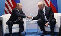 President Donald Trump shakes hands with Russian President Vladimir Putin at the G20 Summit in Hamburg, Germany on Friday, July 7, 2017 (AP Photo/Evan Vucci).