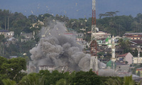 Debris flies as Philippine Air Force fighter jets bomb suspected locations of Muslim militants in Marawi city, southern Philippines on Friday, June 9, 2017. (AP Photo/Aaron Favila, File)